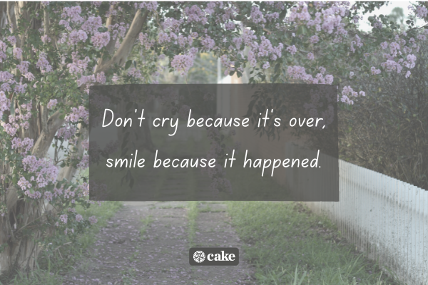 Example of a headstone quote with an image of trees and flowers and a pathway in the background